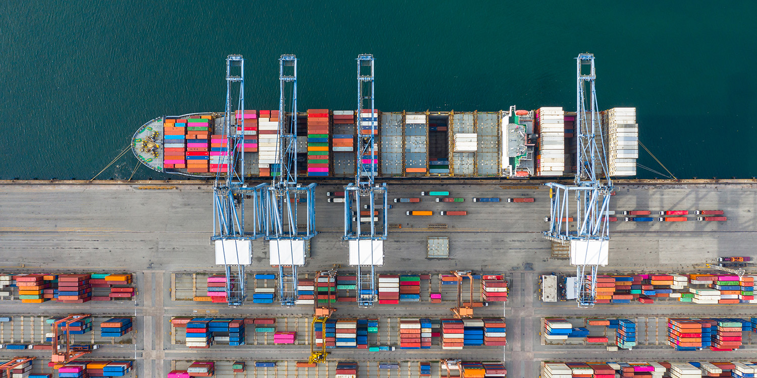 Aerial view container ship carrying container in import export b